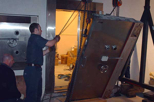 Safe Movers Dismantling Large Safe Door
